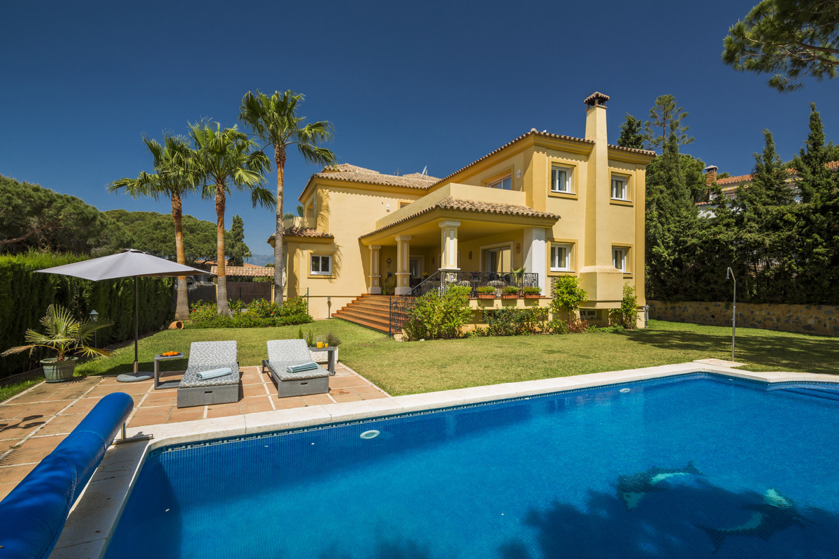 This beautifully decorated villa is comprised of a grand hallway, fully equipped kitchen with a brea,Spain