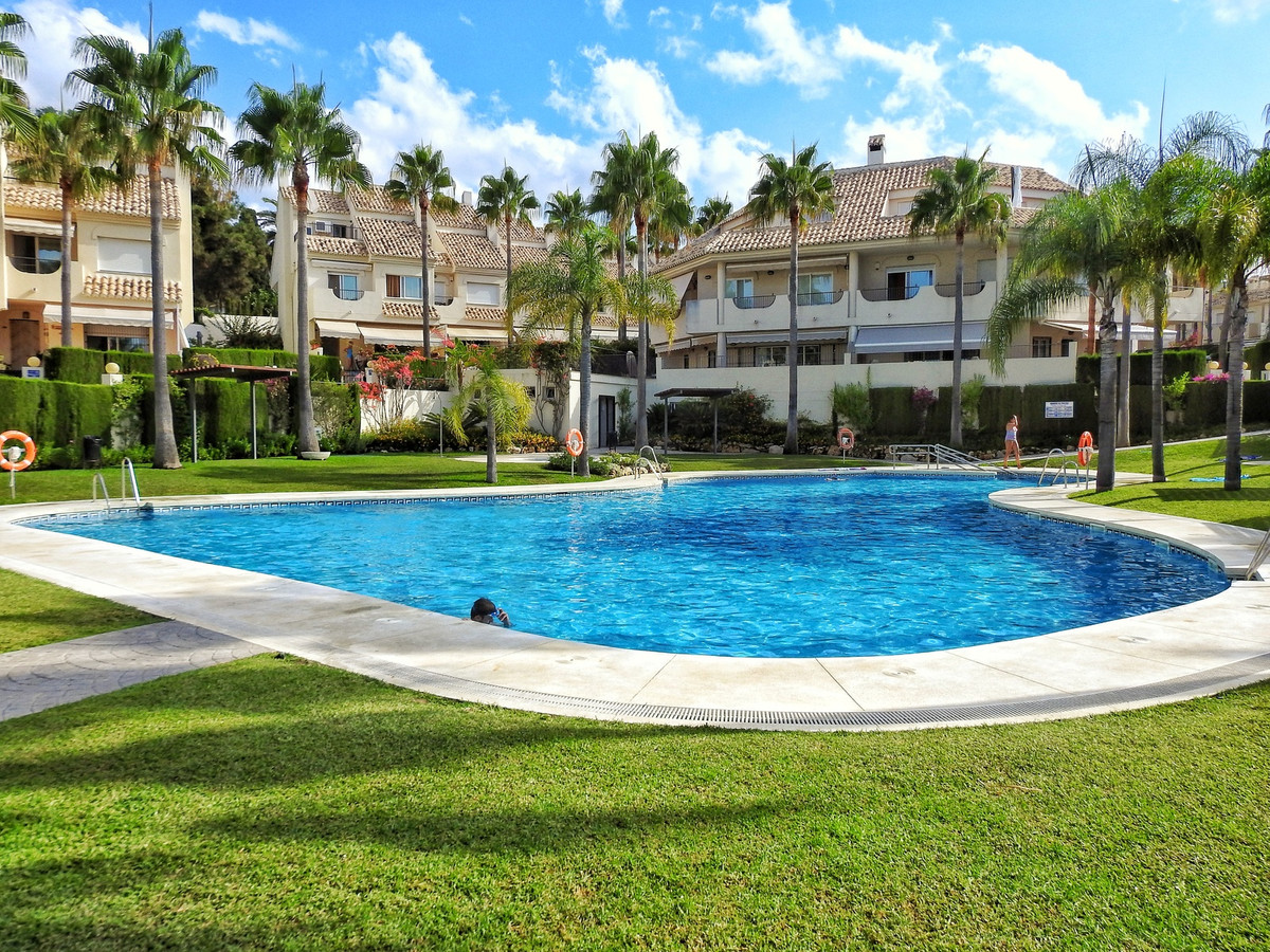 Charming townhouse with 4 floors located in firs line beach residential complex in  Elviria, east of,Spain