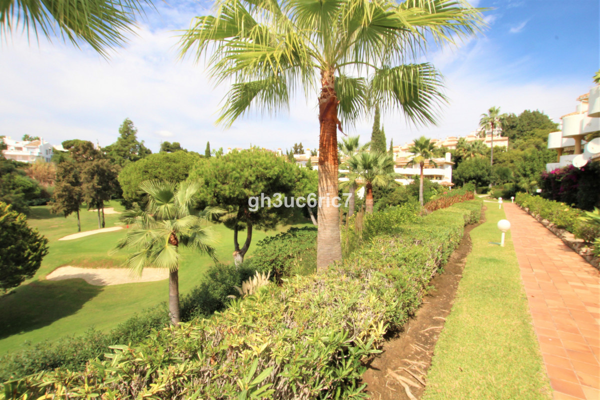 First line golf, ground floor apartment comprising of 2 bedrooms, one bathroom, bright lounge with a Spain