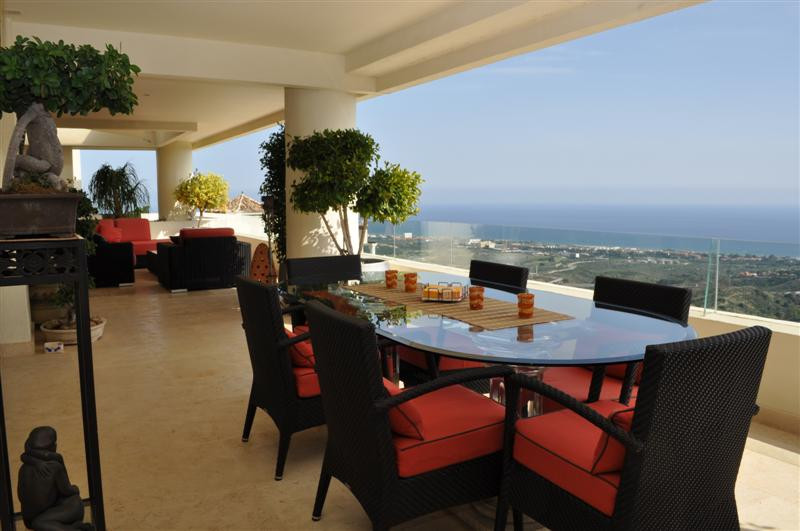 Luxury duplex penthouse with panoramic mountain and sea views. The property is located in the gated,,Spain
