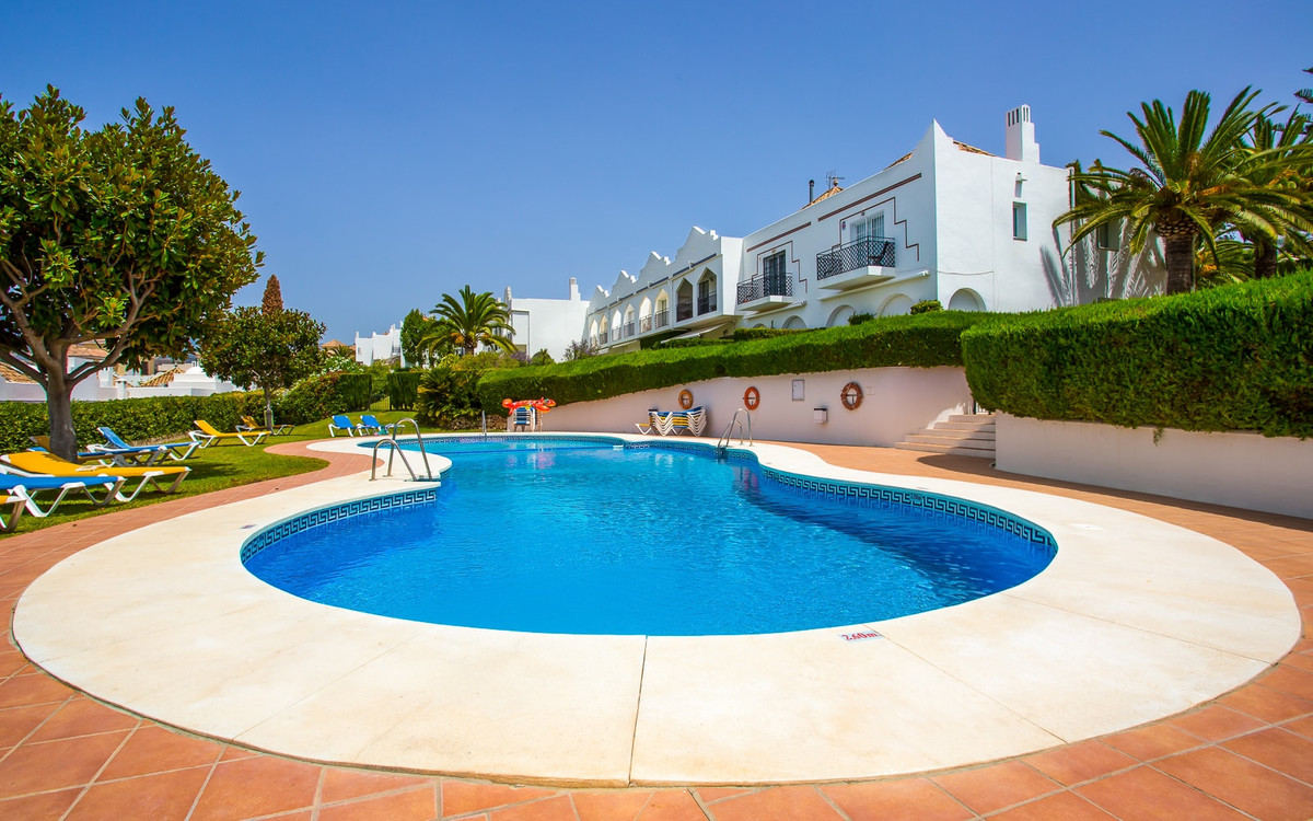 Beautiful townhouse distributed in one floor, located in the heart of the Golf Valley, surrounded by,Spain