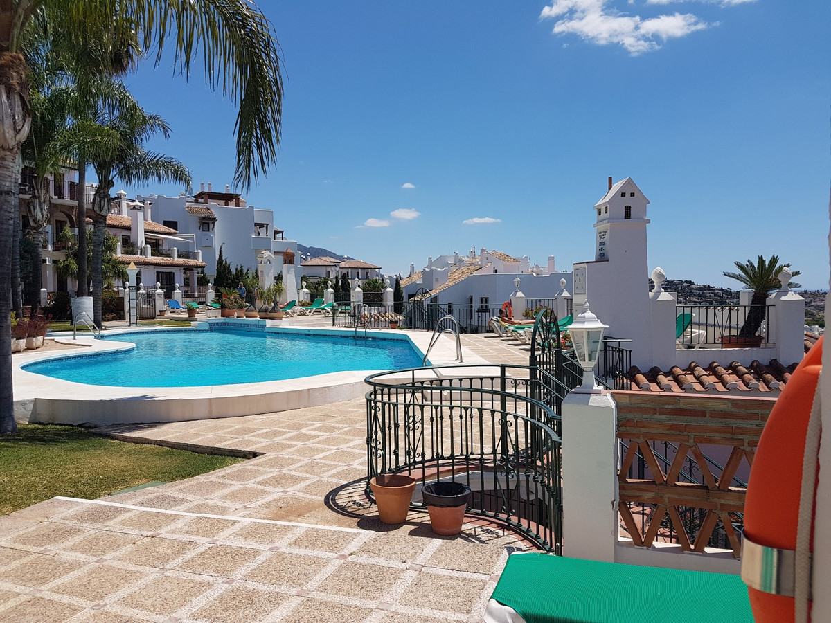 This Mijas Golf Town house has been beautifully maintained by it's current owner.  It has been u,Spain