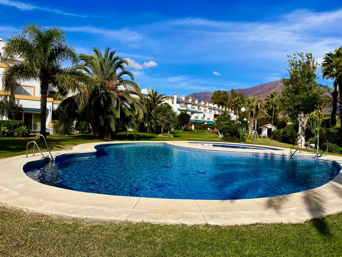 Super town house on the beach side in a gated development, fabulous gardens with two pools, sun on t,Spain