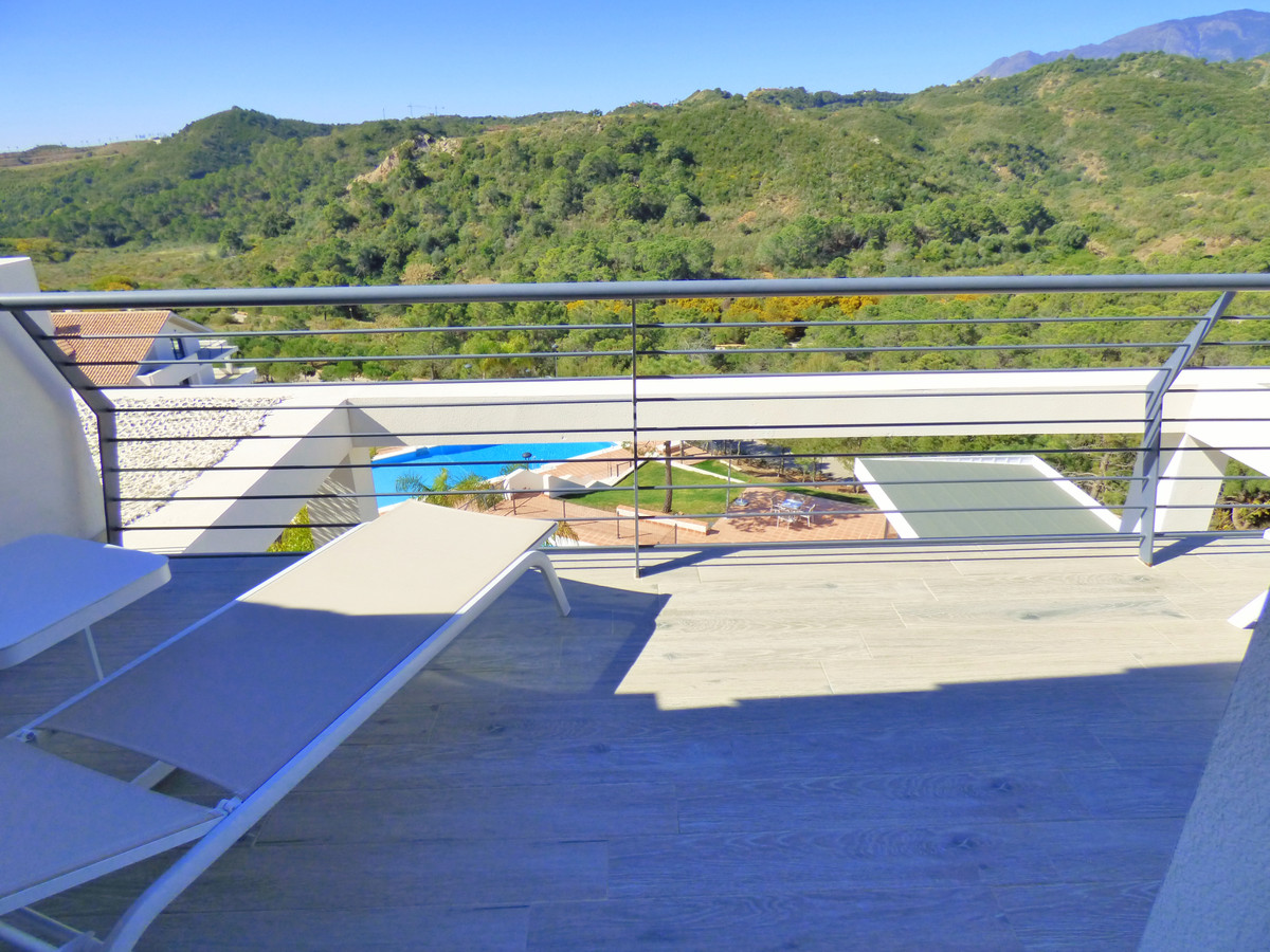 This fabulous duplex penthouse apartment is located close to Estepona, stunning views to the hills a,Spain