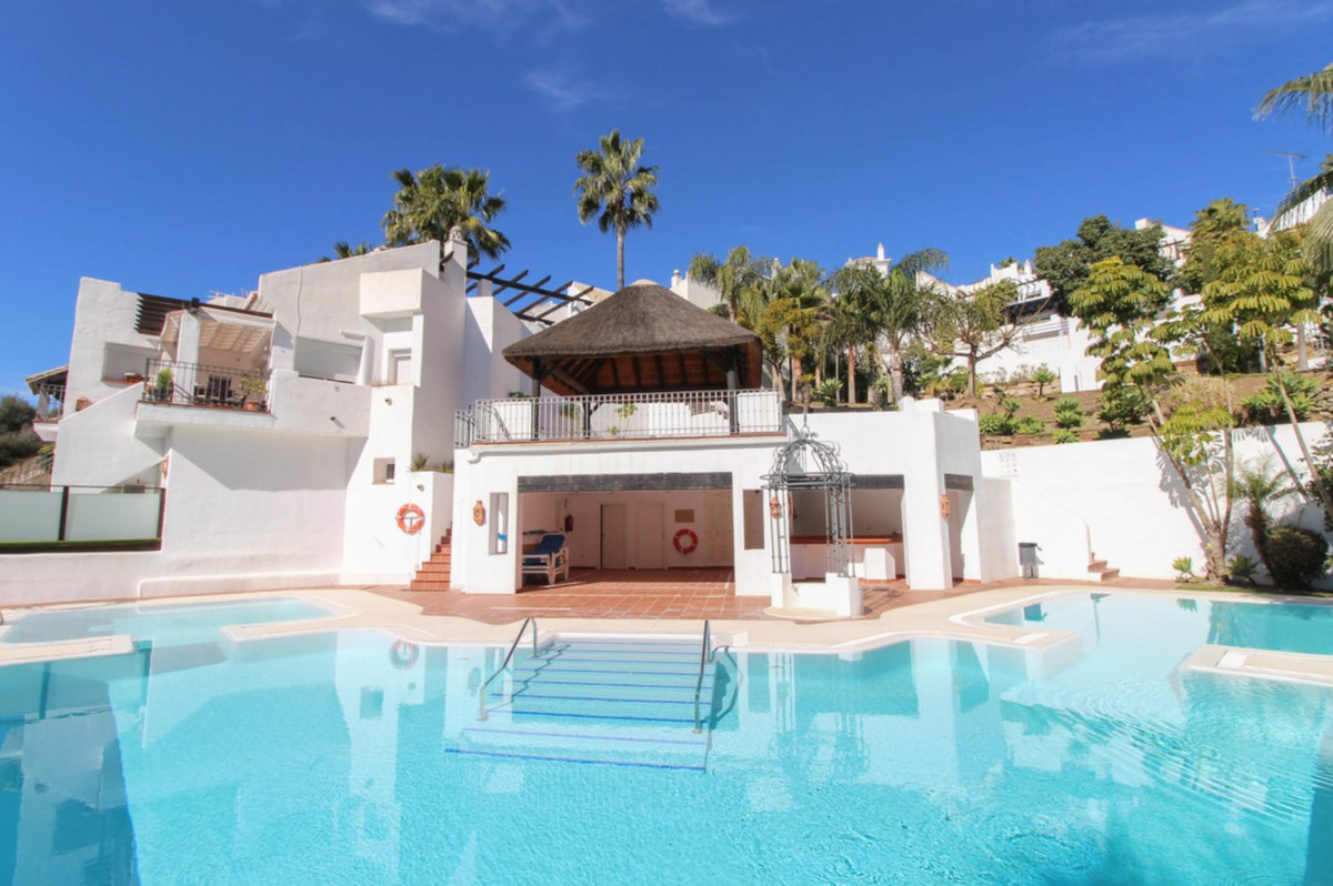 This superb townhouse is built on the edge of a beautiful protected area, featuring a stunning lake ,Spain
