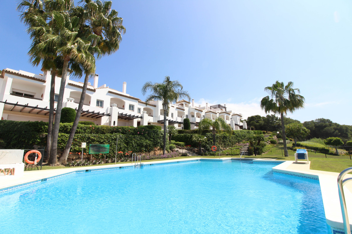 This bright and spacious corner south facing townhouse is situated in the heat of the Aloha Golf Val, Spain