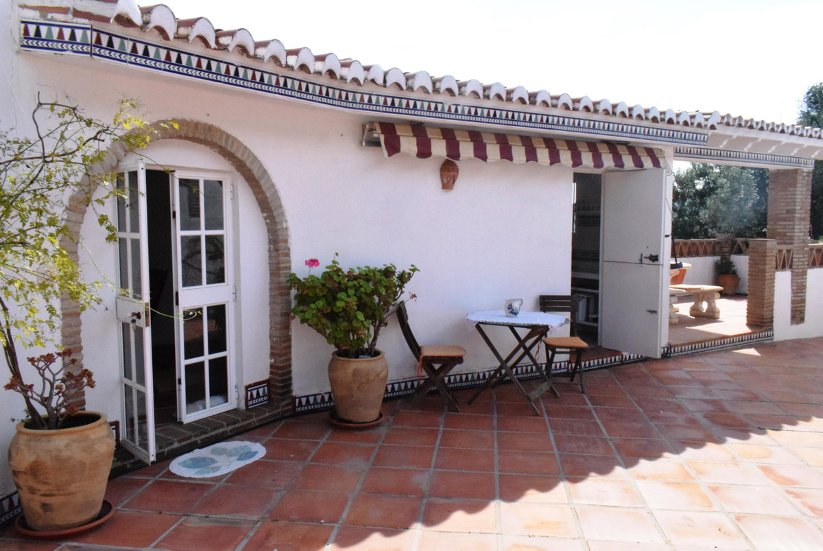 This beautiful Andalusian style villa is located in the countryside of Iznate and has amazing views , Spain