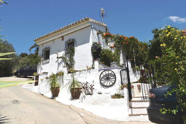 This charming country house is situated in a hamlet 5 minutes drive from Benamargosa. Lovely mature , Spain