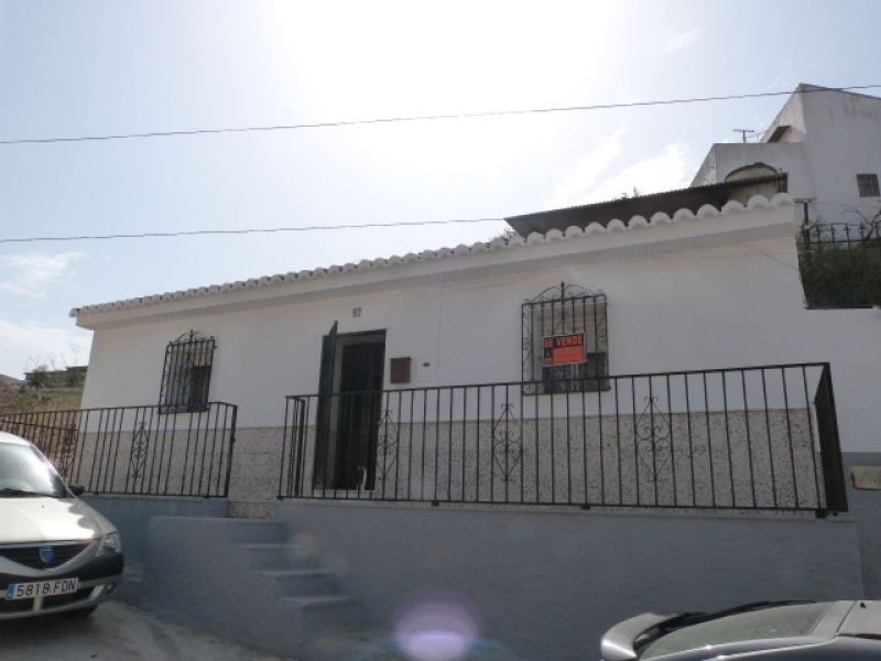 This traditional Spanish townhouse is situated in the upper part of Velez Malaga just minutes away f,Spain