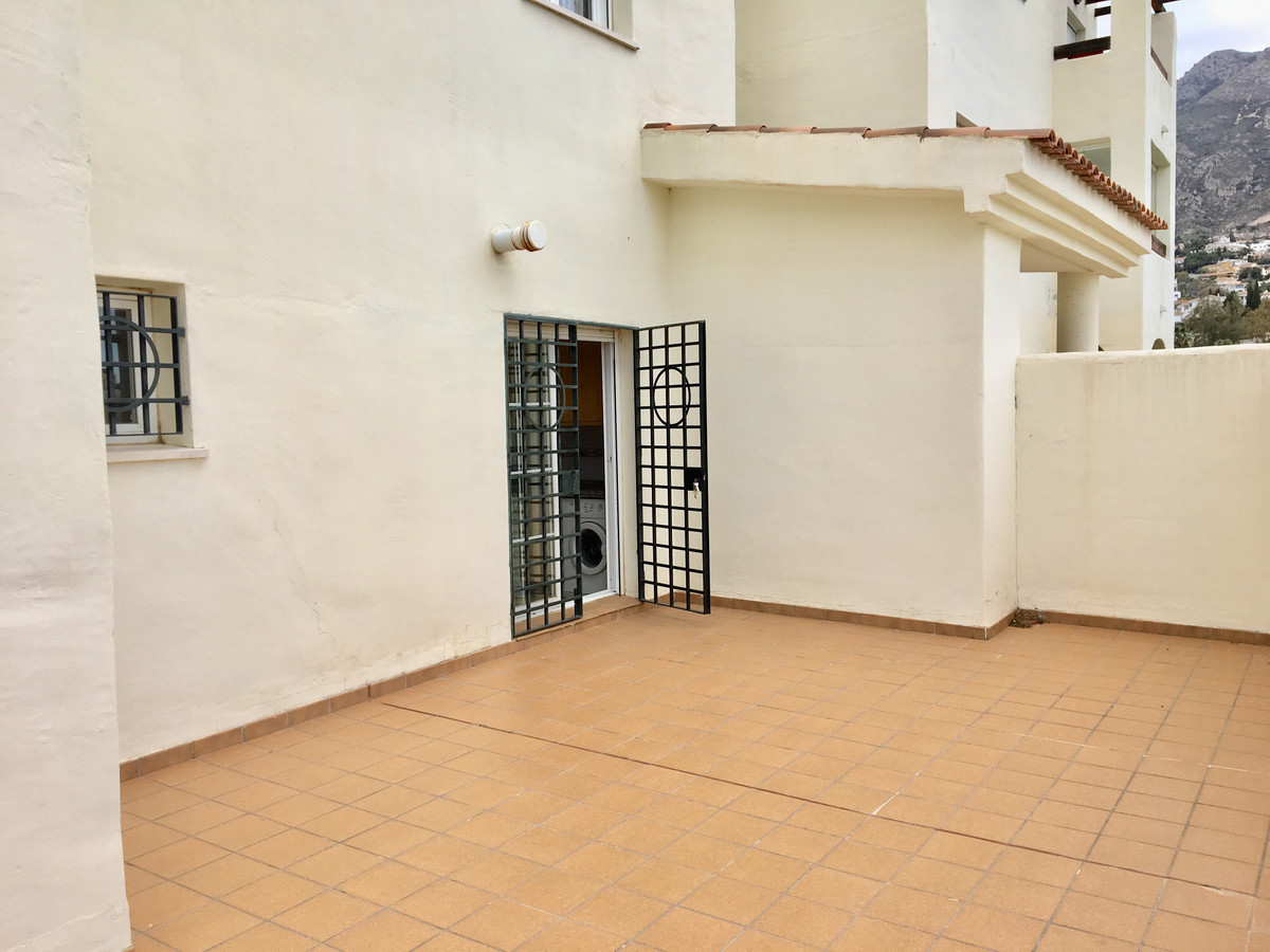 Corner ground floor, 1 bedroom, 1 bathroom apartment with 2 large south/east facing terraces with a ,Spain