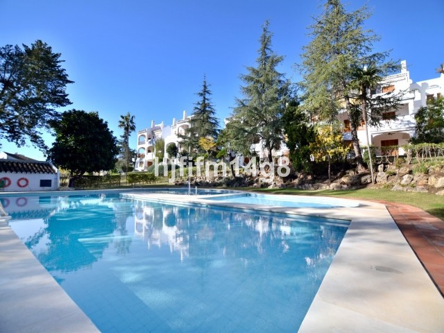 Attractive three bedroom ground floor apartment for sale in a gated complex in the heart of Nueva An,Spain