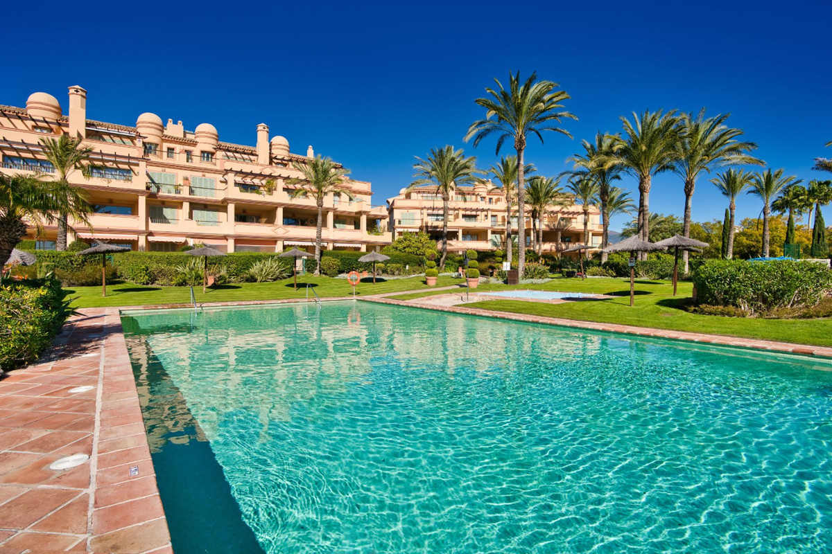 Beautifully appointed 2 bed, 2 bath apartment with sunny private garden, located within the prestigi,Spain