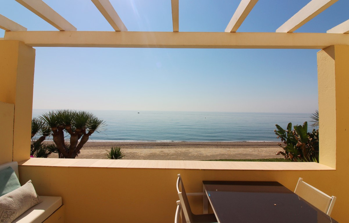 This fantastic front line beach apartment is situated west of Estepona in a quiet urbanization with , Spain