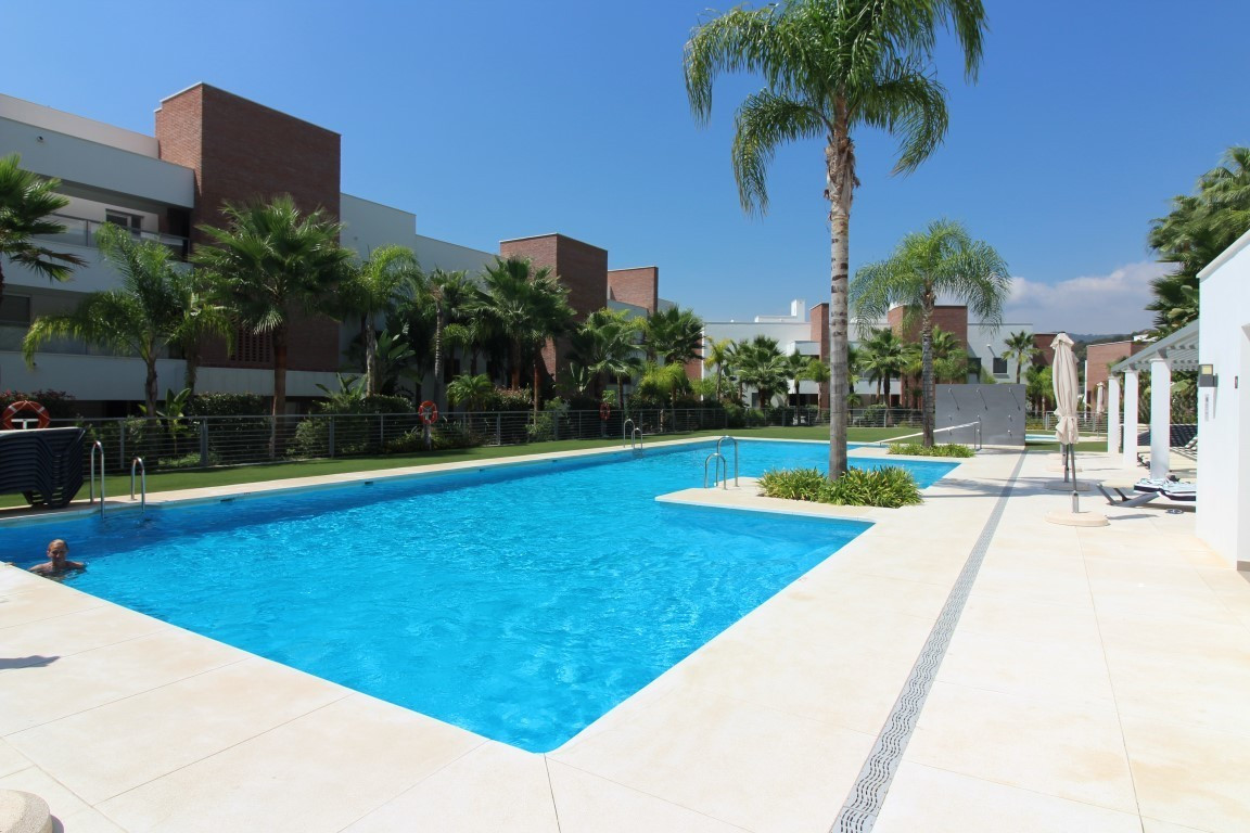 Contemporary apartment situated in a gated complex with tropical gardens with swimming pool. The pro,Spain