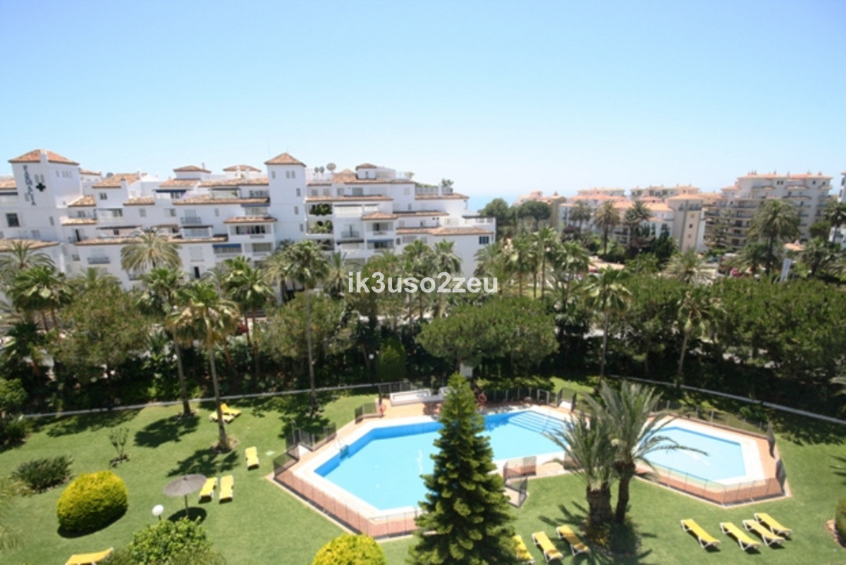 This two-bedroom fourth floor apartment is located in an exclusive residential complex within the he, Spain
