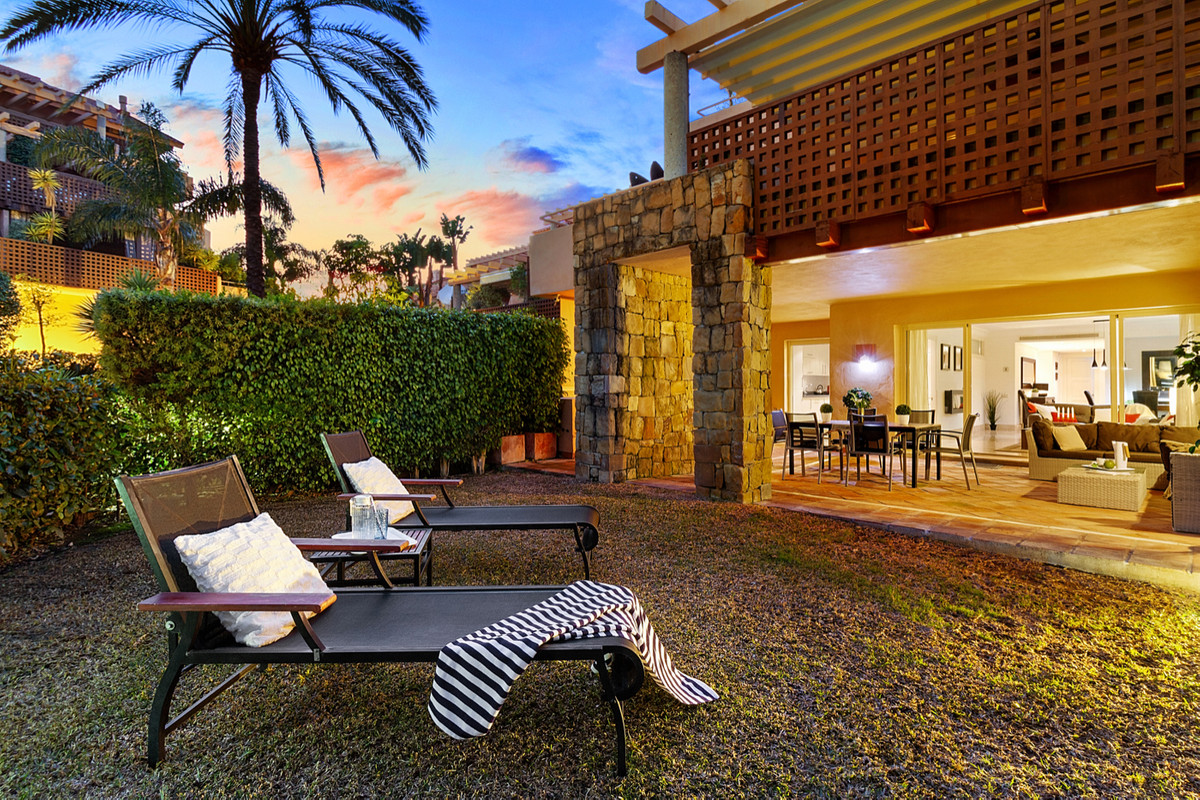 Welcome to this unique ground floor apartment with private garden for sale in Golf Gardens, Rio Real,Spain