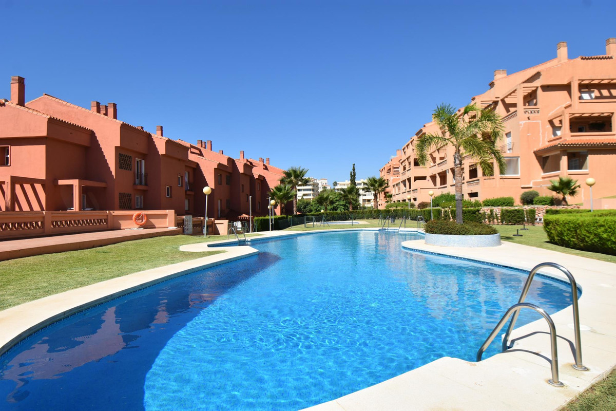 Elevated ground floor apartment with open views in a secure community with pools for kids and adults,Spain