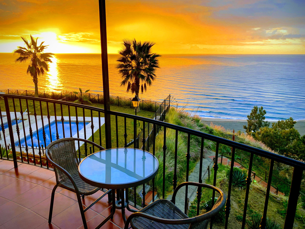 'Orange on the beach': Apartment south oriented with amazing terrace all around and stunning sea view in a gated community with swimming pool.  The apartment is located in a calm area of Benalmadena at the entrance of Fuengirola and overlooks the sea from a small hill and hence provides unique panoramic views!  It consists of a living/dining room fully surrounded by a large terrace, a fully equipped kitchen including dishwasher, coffee and washing machine, a separate bedroom with large storage possibilities and bathroom with tub and shower. The apartment is air conditioned throughout and also has WiFi internet.   Free parking is possible at the vicinity of the gated complex where the swimming pool is accessible for community only. Basic food is available 4min walk from the apartment at a gas station while a small supermarket is just 150m away. A Carrefour supermarket is at a 5min drive journey.  The large and sandy beach of Carvajal is just at 5min walk and you can enjoy typical bars and restaurants or walk along the wonderful promenade that will bring you to the port of Fuengirola.  If you prefer public transportation, the train station of Carvajal is 10min walk away. There is a train every 20min and it will bring you either to Fuengirola (10min) or to the airport (30min). The train also stops at a series of stations between these 2 terminuses.  License: CTC-2018199168