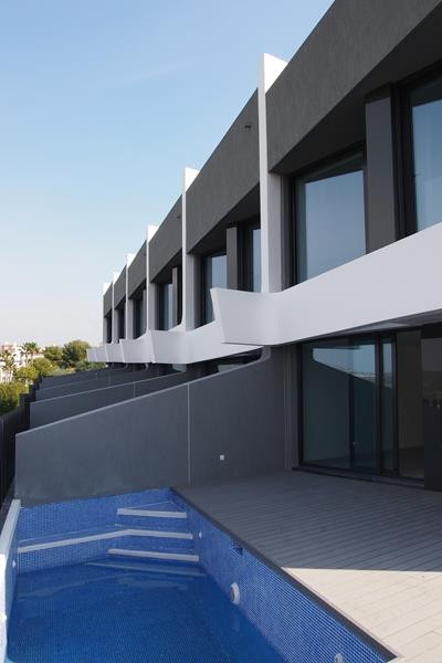 A new development of modern contemporary townhouses designed by award winning architects Joaquin Tor,Spain