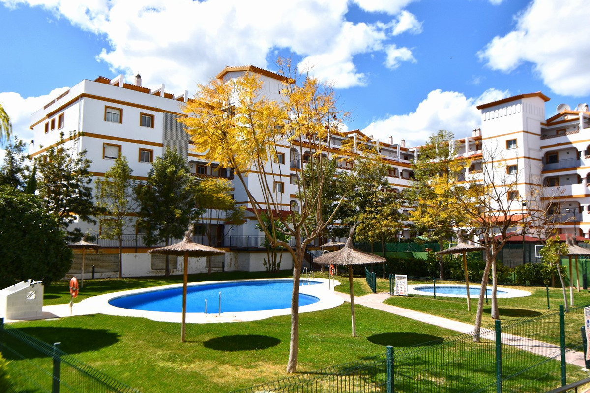 Modern 2 bedroom 1 bathroom apartment in the popular complex Hacienda de Golf! This community has fantastic shared garden areas with multiple swimming pools, tennis courts and bar (open in peak Summer periods only). There is also a small supermarket right next door and several restaurants in walking distance!   Mijas Golf course club house is just a couple of minutes drive away and there is also a large public BBQ park right next to the community (closed Summer season due to fire risks). The towns of Fuengirola and la Cala de Mijas which have many attractions (aquaparks/zoos/amusement parks/markets/sandy beaches) are just 10 minutes drive away in each direction!  The apartment itself is well equipped with WiFi internet, UK TV channels, fully equipped modern kitchen, air conditioning throughout, 2 bedrooms (sleeps 4) and one bathroom. The terrace is quite large with lovely southwest facing countryside views!  Available to rent short term year round. Longer stays available in winter months (September to May each year) at reduced monthly rates - ask for a quote as these rates do not appear on the webpage! The longer you stay, the lower the rate!  VFT/MA/17703