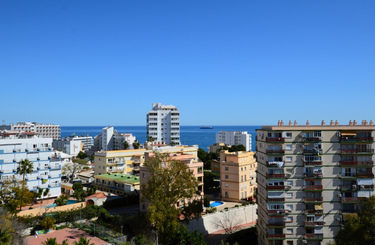 Modern refurbished holiday rental apartment in the popular Jupiter complex next to the town of Arroyo de la Miel, walking distance to the beaches of Benalmadena! Also walking distance to all amenities including hundreds of restaurants, cafes, bars, shops and supermarkets, attractions such as Dolphin Park, natural & kids park, amusement park and more! 15 minute drive from Málaga Airport.  With sea views from private terrace, fabulous communal swimming pools (one pool open year round and full pools with slides and pool bar open July and August) this is a great place for a budget family beach holiday. The studio apartment itself has equipped kitchen ideal for self-catering holidays, washing machine, shower room, double bed, 2nd double sofa bed, dining table (extendable), built in wardrobes, iron + ironing board, TV with a few international (including English) channels & DVD player.   Prices include cleaning before and after, bed linen, bath towels and utilities. Special monthly winter rates available for stays of 1 month and over between October and April each year - enquire for full details!