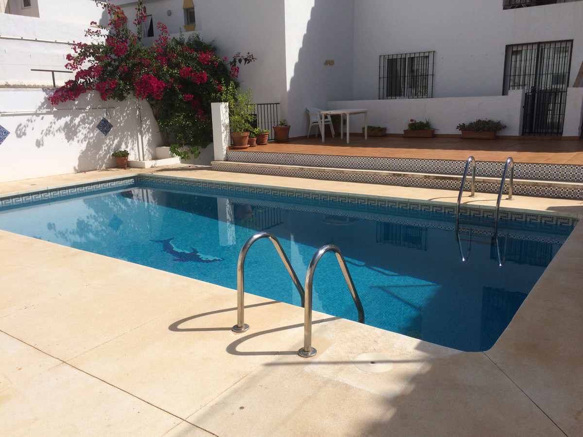 IDYLLIC TOP FLOOR APARTMENT IN MIJAS PUEBLO  Set in a small complex of apartments with communal pool,Spain