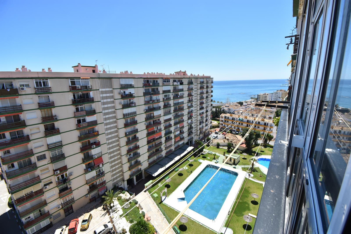 Beachside studio in Benalmadena in a gated community with communal pools for kids and adults, green , Spain