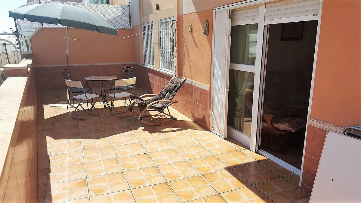 At just a few meters from Torrox beach, this spacious 2 bedroom 2 bathroom apartment is ideal as a f, Spain