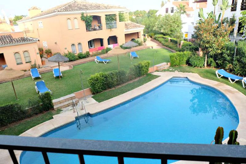 LARGE GROUNDFLOOR APARTMENT SITUATED IN A GATED MOORISH STYLE URBANIZATION WITH PRETTY COMMUNAL GARD,Spain