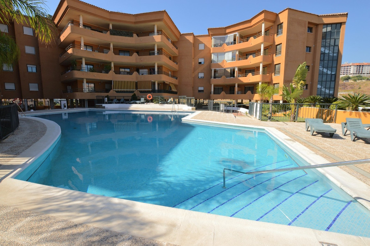 "Stunning sea views from modern 2 bedroom apartment in Fuengirola, with communal pool, air conditioning throughout and spacious private terrace!   This apartment is located just 20 minutes drive from Málaga Airport, a short 5 minute drive from Fuengirola's stunning golden sandy beaches and many attractions such as:  - Mijas Aquapark! - Bioparc - award winning Zoo in Fuengirola with educative interactive shows and incredible natural enclosures (also open late in Summer to see nocturnal animals!). - Tivoli Amusement Park in Benalmadena! - Selwo Marina - dolphin and sea lion shows, situated in Benalmadena! - Sea Life Center - situated in Benalmadena Marina! - Cable Car to the top of the mountains of Málaga from Benalmadena!  - Torremolinos ""Aqualand"" water park - the biggest in the area and highly recommended! - Crocodile Park - situated in Torremolinos. - Selwo Aventura - Safari adventure park. - Miramar indoor commercial center - with many shops, supermarkets, restaurants and English cinema (don't miss any new films whilst on holiday!) - Sould Park - lovely little mini theme park right next to Fuengirola Marina, for younger children!  This apartment is excellent value for a family looking to enjoy a beach holiday and a few of the fantastic attractions in the area!   We are able to offer airport transfers to and from the airport in your holiday stay and taxis are only around €5-10 to the nearby town of Fuengirola, so hire cars are by no means 100% required (though recommended.   Longer stays available in Winter months at discounted monthly rates (which won't appear here on the webpage, so inquire for our best price!)."