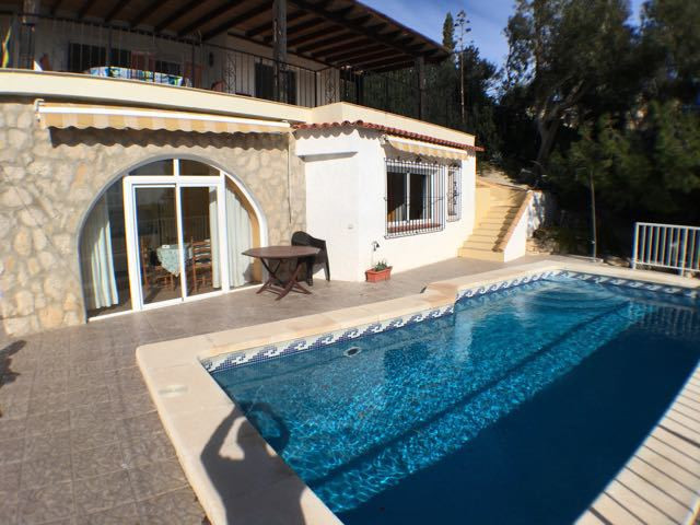 Seafront villa, lovingly renovated with picture postcard location and sea views; next to sandy cove.,Spain
