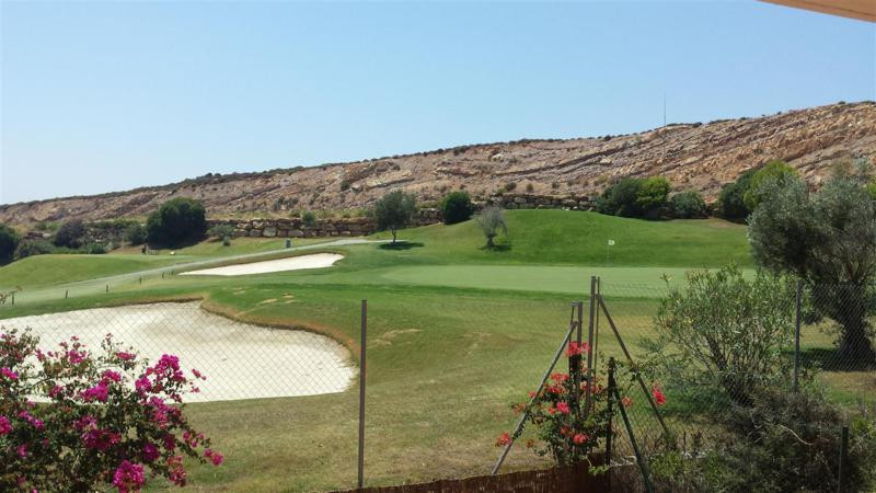 Front line Golf elevated ground floor apartment with seperate self contained basement apartment. Gro, Spain