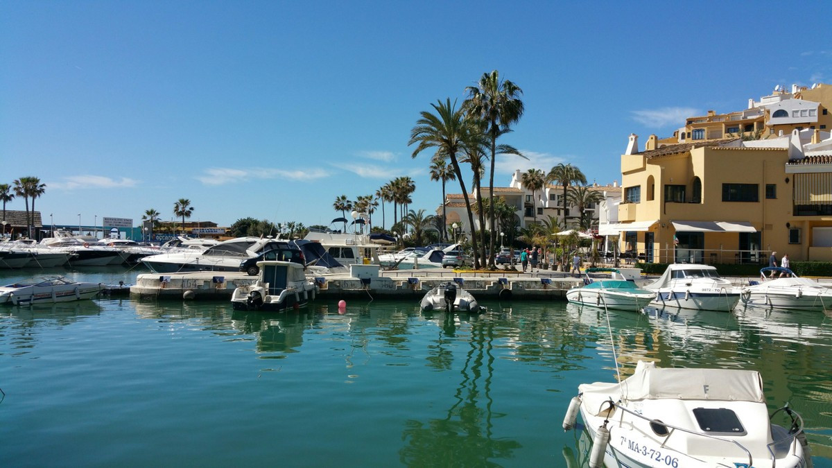 This is a super renovated apartment in the famous port complex by the port of Caboipno.  The propert,Spain