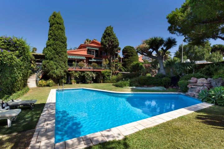 REDUCED FROM €1,050,000 to € 890, 000! This impressive Mediterranean style villa is located within a,Spain