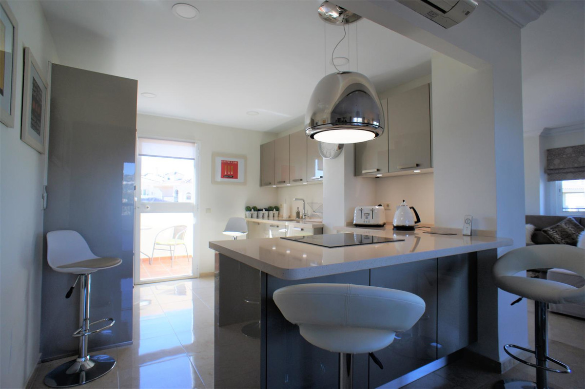 Beautiful renovated penthouse with a brand new open plan kitchen. The glass curtains have created an, Spain