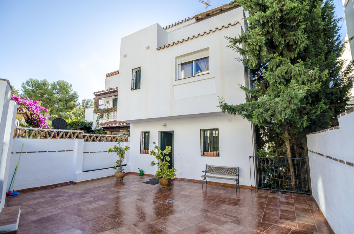 Spacious semi-detached townhouse with private patio in the front and parking in Mijas Jardin, Campo ,Spain