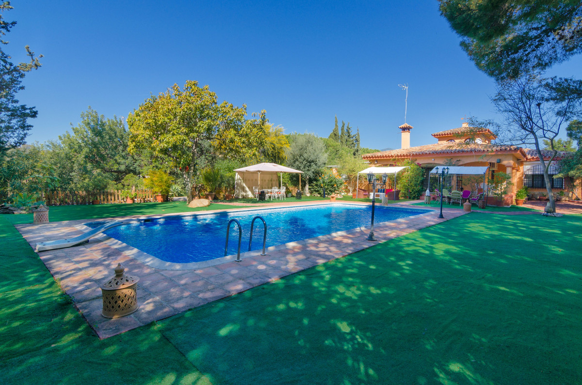 Impressive rustic finca, 1 km from the beach of Estepona. It has 3 houses, large garden with pool, a, Spain