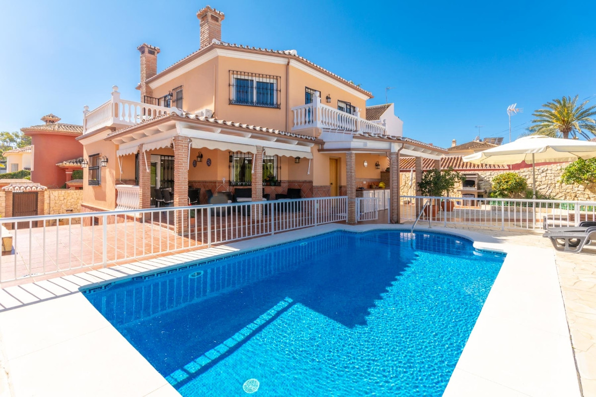 Fantastic Villa in Playamar just 500 meters from the beach.  It is distributed as follows: Ground Fl, Spain