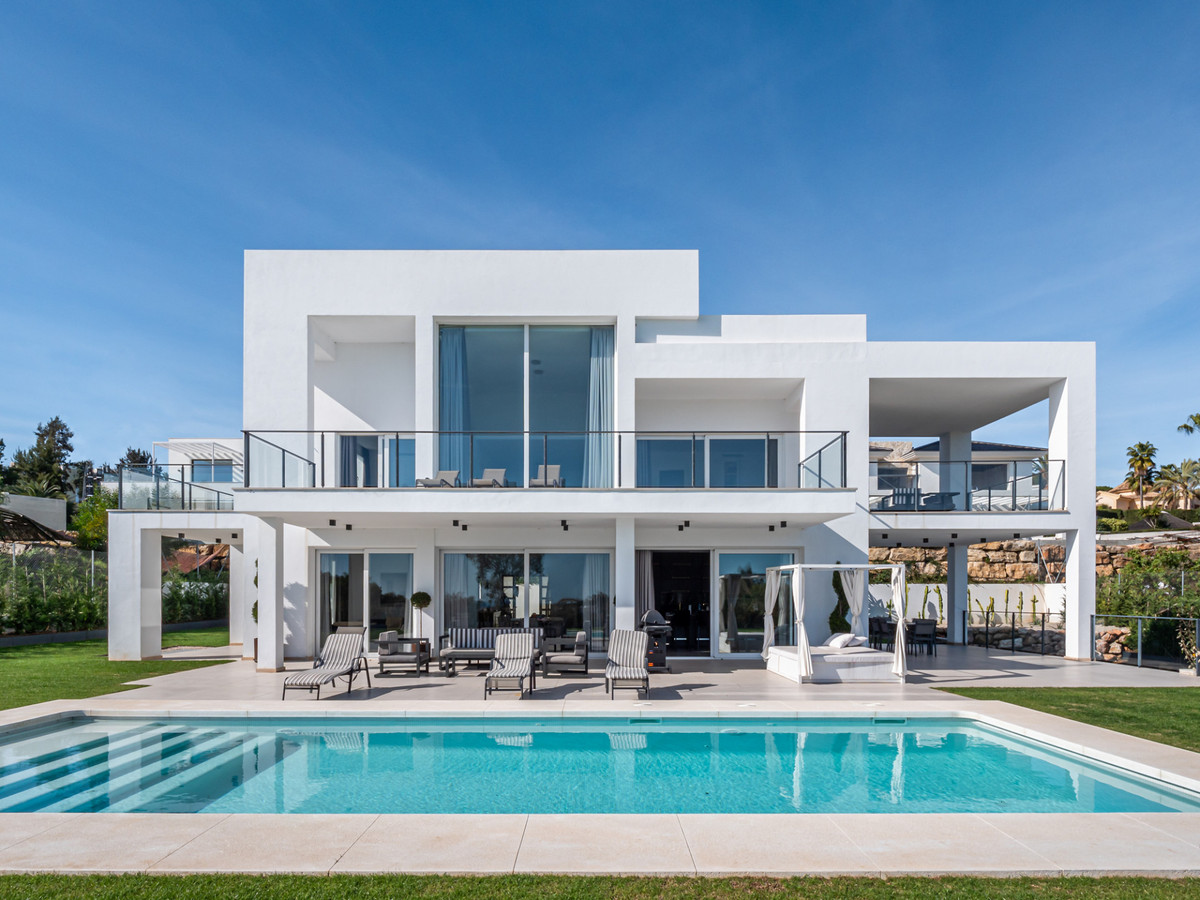 This villa was completed in 2018 and has 4 en-suite bedrooms. On the ground floor, the double-height,Spain