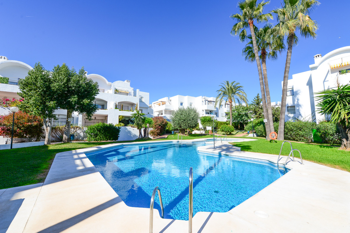 Lovely south facing garden apartment situated in gated community with all amenities, restaurants, ca, Spain