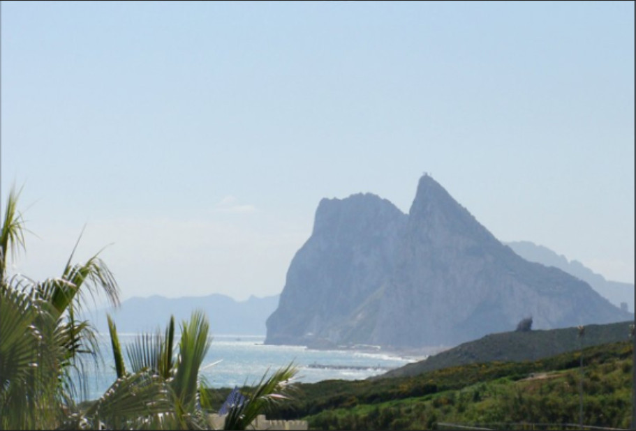 On a Links golf course with views of the rock of Gibraltar