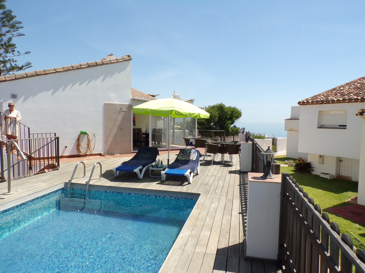 Detached beachfront villa with pool