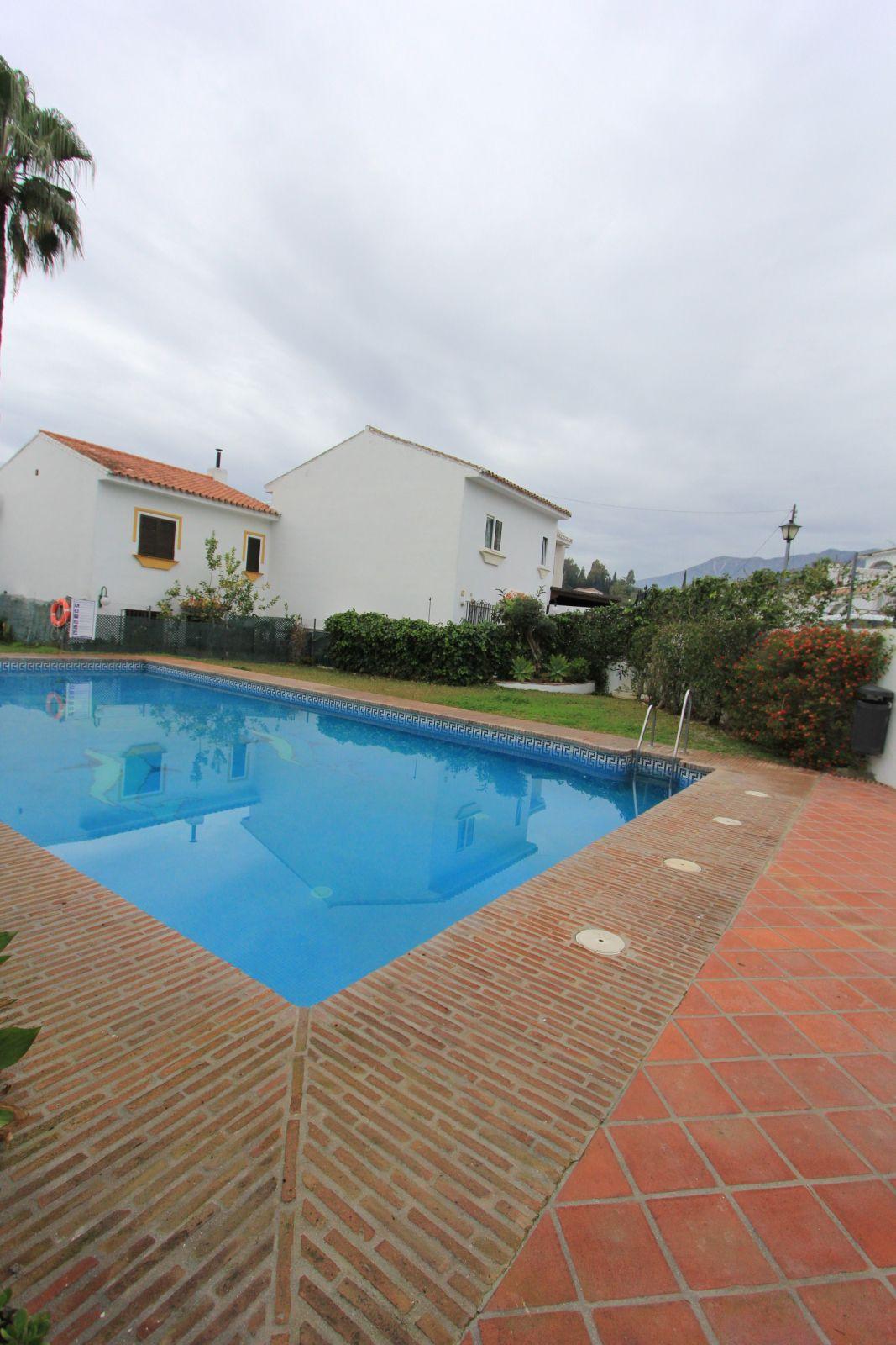 Townhouse for sale in urbanizacion Las Lomas del Coto. It has 3 bedrooms, 3 bathrooms, a living room,Spain