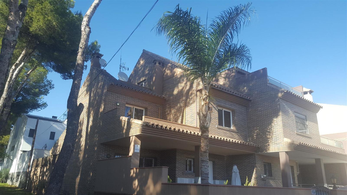 A recently constructed semi detached house on a quiet street in El Coto.  The property has a large u, Spain