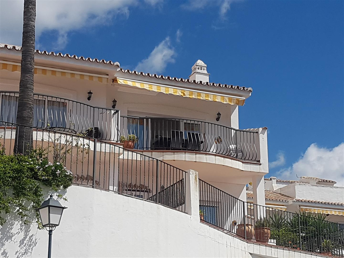 An immaculate 2 bed 2 bath corner townhouse in a good urbanisation on the Mijas road that also benef,Spain