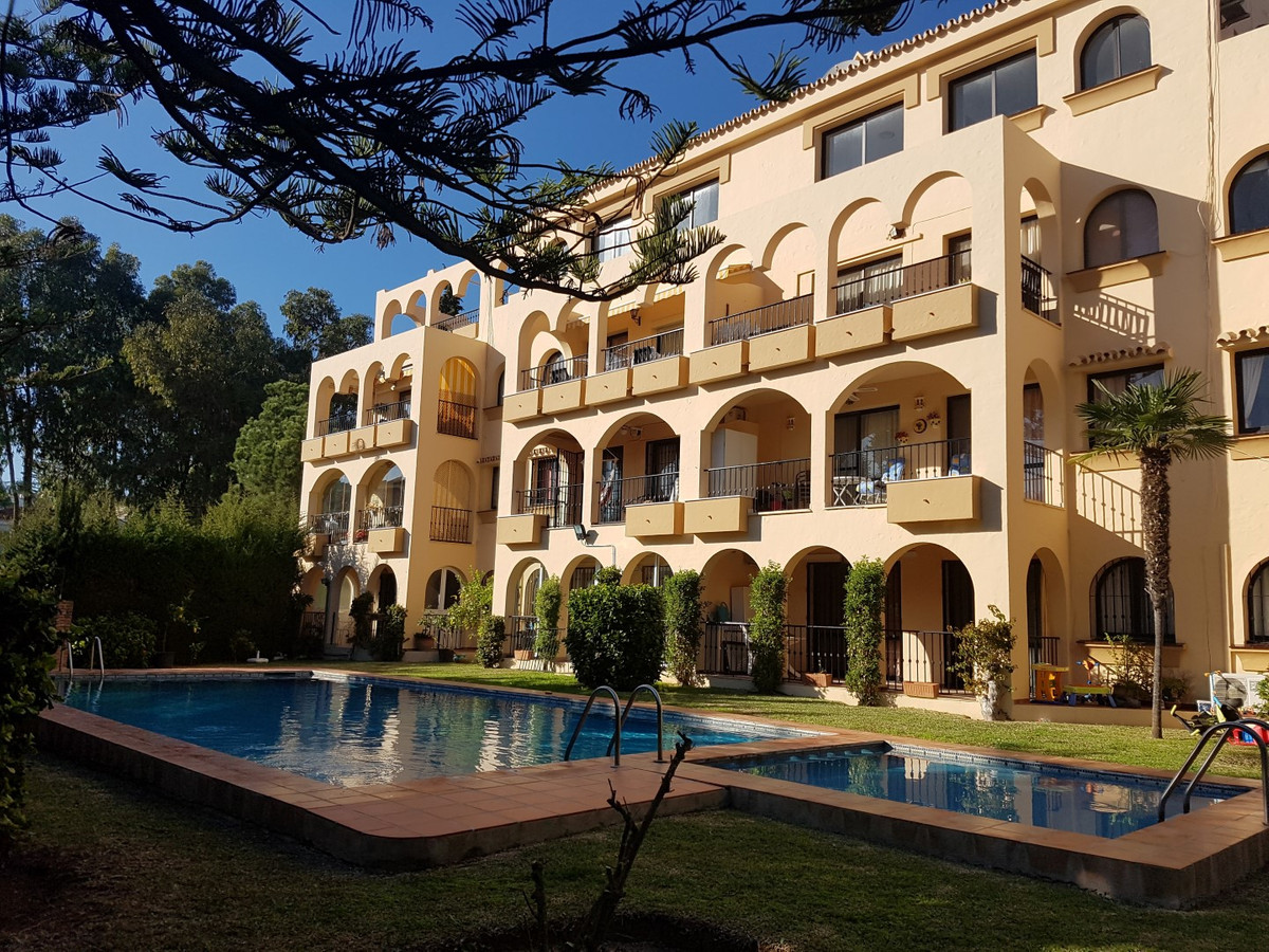 An immaculate two bedroom apartment with a large south facing sunny terrace overlooking the communal, Spain
