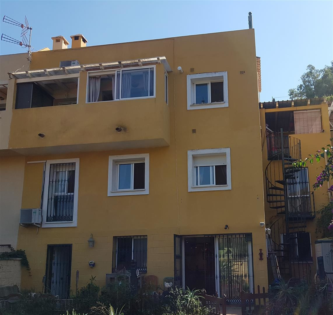 A large semi-detached townhouse with large front and back gardens and off-street covered parking for, Spain