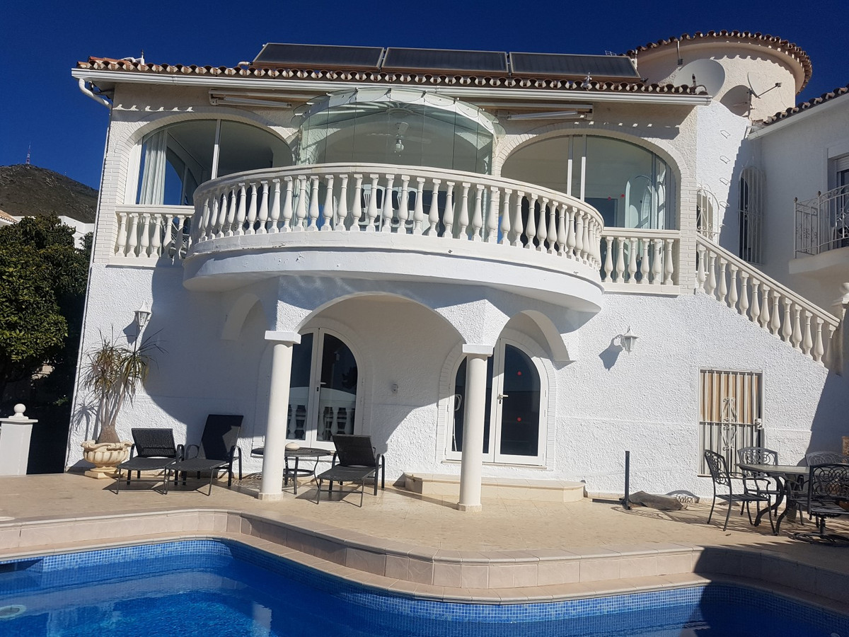 A beautiful villa in La Capellania with panoramic sea and mountain views and on a large walled and g Spain