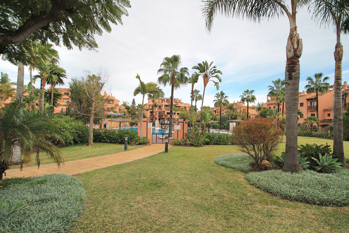 Perfectly presented three bedroom, east facing, ground floor apartment with views to the pool and im,Spain