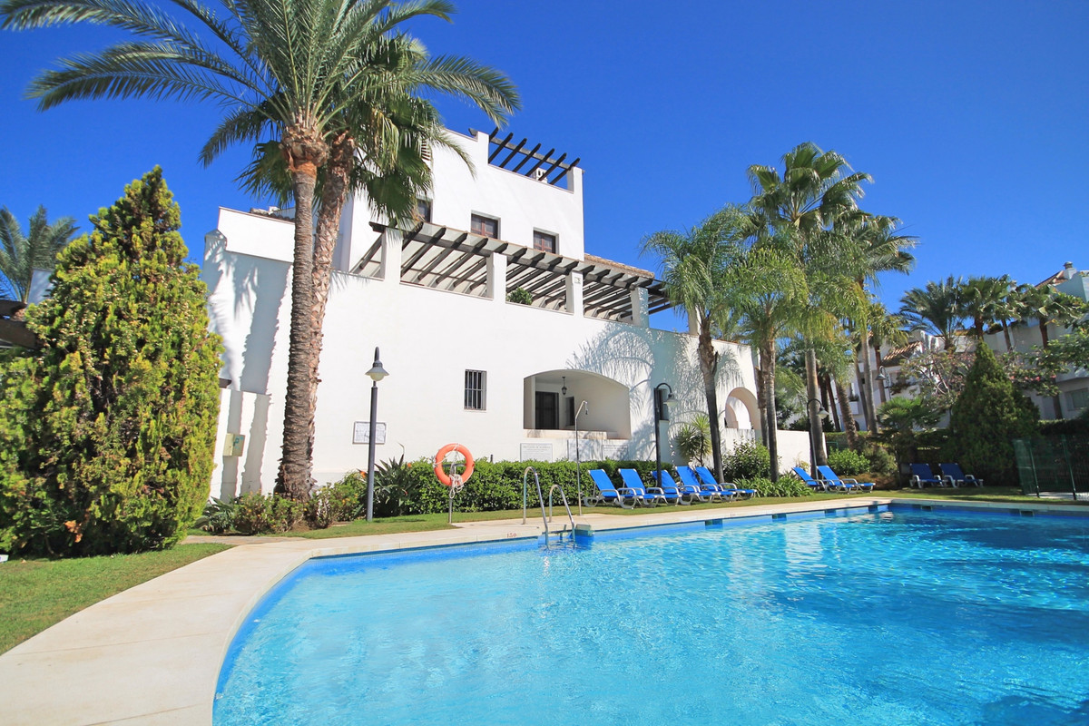 Perfectly located, two bedroom ground floor apartment with huge terrace in a tranquil beachside loca,Spain